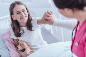 Girl giving high five to doctor