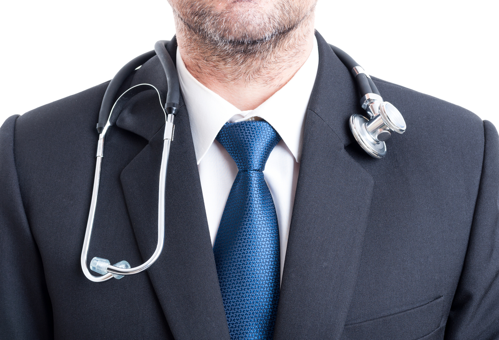 Male doctor with suit and stethoscope