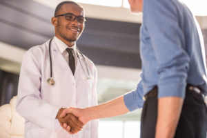 Provider shaking hands with a healthcare leader